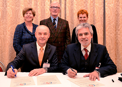 A picture of founding members signing the Memorandum of Association